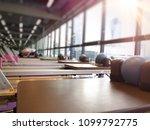 pilates reformer workout... | Shutterstock . vector #1099792775