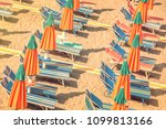 colorful reclining chairs and... | Shutterstock . vector #1099813166