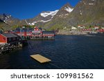 Picturesque village on Lofoten islands in Norway surrounded by mountains - stock photo