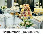 wedding dessert table. making... | Shutterstock . vector #1099883342