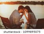 young couple in love flirting... | Shutterstock . vector #1099895075