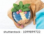smoothie bowl with blue... | Shutterstock . vector #1099899722