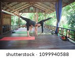 young girls practicing yoga... | Shutterstock . vector #1099940588