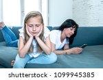 digital technology addicted mum ... | Shutterstock . vector #1099945385