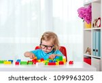 cute little girl playing with... | Shutterstock . vector #1099963205