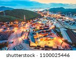 container yard in tranfering... | Shutterstock . vector #1100025446