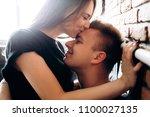 the lovely couple in love... | Shutterstock . vector #1100027135