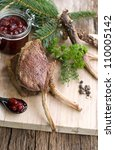 Venison chops on wooden ground - stock photo