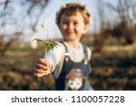 the beautiful  girl keeps a...   Shutterstock . vector #1100057228