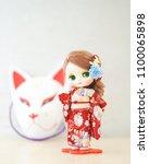 cute doll in kimono. a cute... | Shutterstock . vector #1100065898