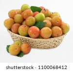 yellow plums in the basket | Shutterstock . vector #1100068412