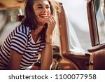 beautiful woman sitting in a... | Shutterstock . vector #1100077958