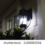the lights at the resort are... | Shutterstock . vector #1100082536