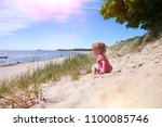 little  girl l at the beach... | Shutterstock . vector #1100085746