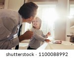 father and daughter brushing... | Shutterstock . vector #1100088992