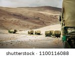 military truck convoy on the... | Shutterstock . vector #1100116088