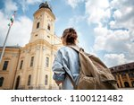 a young woman traveler visiting ... | Shutterstock . vector #1100121482