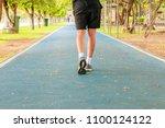 running feet male in runner...   Shutterstock . vector #1100124122