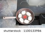 cheese pancakes in frying pan... | Shutterstock . vector #1100133986