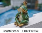 A Frog Decoration At The Garden