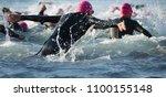 group triathlon participants... | Shutterstock . vector #1100155148
