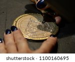 engraver engrave the drawing on ... | Shutterstock . vector #1100160695