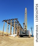 Small photo of BAKERSFIELD, CA - MAY 28, 2018: Now that huge concrete columns are in place the steel roadway structure begins to span between them during construction of the Westside Parkway Project.