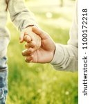 father child hands close up | Shutterstock . vector #1100172218
