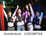 happy young people with laser...   Shutterstock . vector #1100180768