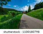 a nice small path to walk on in ... | Shutterstock . vector #1100180798