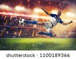 soccer striker hits the ball... | Shutterstock . vector #1100189366