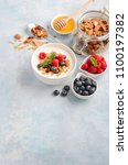 homemade granola with yogurt... | Shutterstock . vector #1100197382