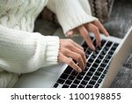 hands of woman typing on... | Shutterstock . vector #1100198855
