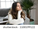 pensive thoughtful young girl... | Shutterstock . vector #1100199122