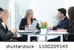 business partners discussing a... | Shutterstock . vector #1100209145