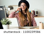 shot of pretty young business... | Shutterstock . vector #1100239586