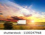 white box truck driving fast on ... | Shutterstock . vector #1100247968