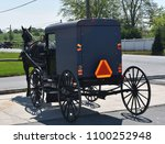 parked horse drawn amish buggy...   Shutterstock . vector #1100252948