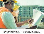 multi ethnic civil engineers or ... | Shutterstock . vector #1100253032