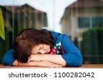 sadness senior woman having a... | Shutterstock . vector #1100282042