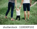 happy family walking in the... | Shutterstock . vector #1100309102