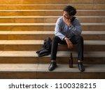 businessman sitting in outdoors ... | Shutterstock . vector #1100328215