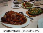 roasted duck and assorted... | Shutterstock . vector #1100342492