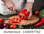 chef cutting vegetables with... | Shutterstock . vector #1100357762