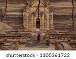 a young monk coming to ancient... | Shutterstock . vector #1100361722