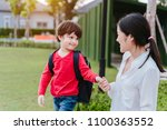 mother get a son pupil from... | Shutterstock . vector #1100363552
