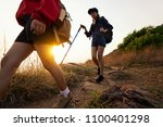 lady hikers walking in the... | Shutterstock . vector #1100401298