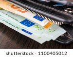 open wallet with euro cash 10... | Shutterstock . vector #1100405012