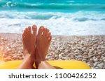 closeup photo of a women's feet ... | Shutterstock . vector #1100426252