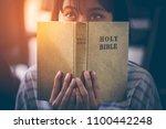 asian teenage girl reading the... | Shutterstock . vector #1100442248
